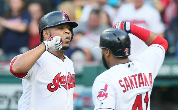 Cleveland Indians Edwin Encarnacion bashes arms with Carlos Santana after hitting a solo home run against the Toronto Blue Jays in the 2nd inning at Progressive Field, on July 21, 2017. (Chuck Crow/The Plain Dealer). Indians won 13-3