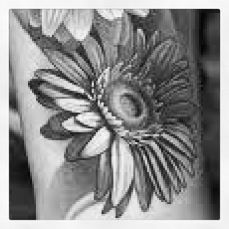 Black and grey Gerbera tattoo