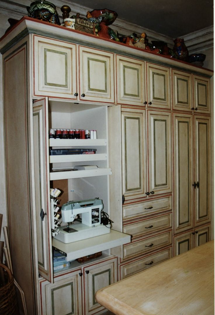 Sewing Craft Room Design Ideas - Pull out sewing machine shelf ...