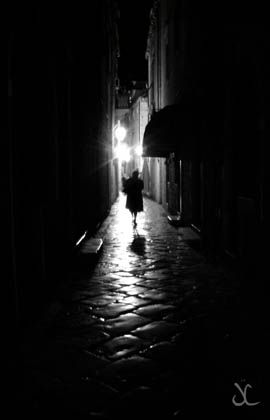 I photographed this picture on a November evening in Dubrovnik, Croatia in 2007. I felt the image evoked an eerie mystical quality. The city landscape with its light and shadow conveyed a sense of a dark romantic noir which would not look out of place in a classic black and white movie.