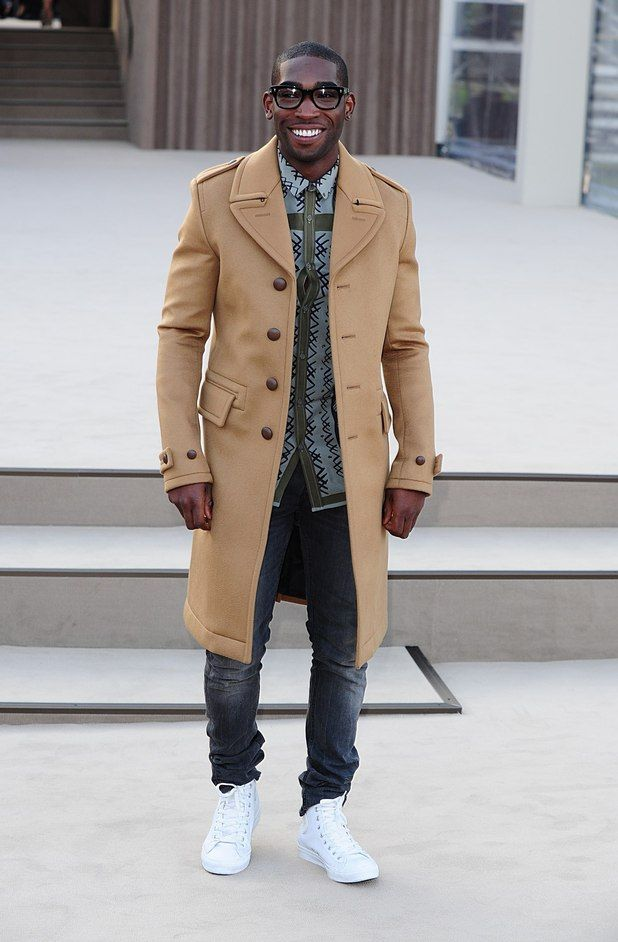 Tinie Tempah attends the Burberry Prorsum show for London Fashion Week.