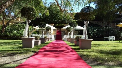 Caversham house wedding ceremony in the hidden gardens.
