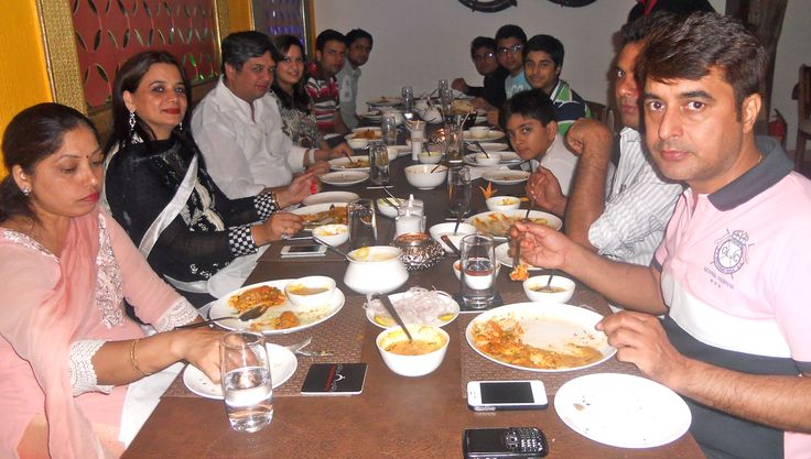 Ashok with family & friends enjoying a meal at The Golconda Bowl, Hauz Khas Village
