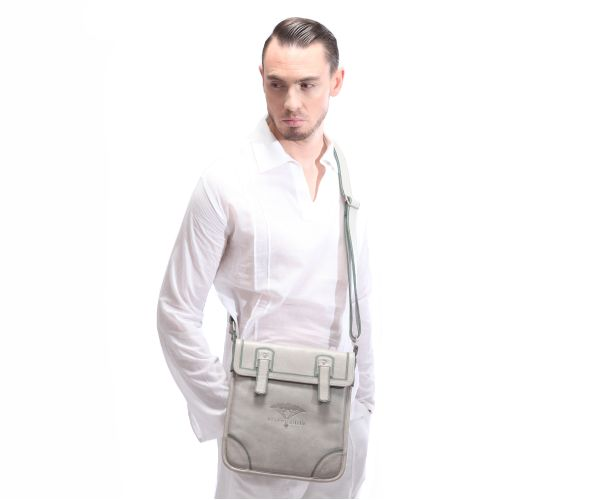 An ipad satchel for the modern traveller for your ipad, phone and travel wallet! In soft grey and pistachio green trimmings with an adjustable shoulder strap. #leather #ipad #bag #grey #fashion