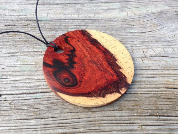 Circular wood pendant necklace made from cocobolo