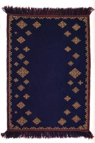 Another lovely villaine, or shawl.  The site claims it was dyed with blueberries, a plant native to North America. The original shawls would most likely have been dyed with woad to achieve the rich navy blue.