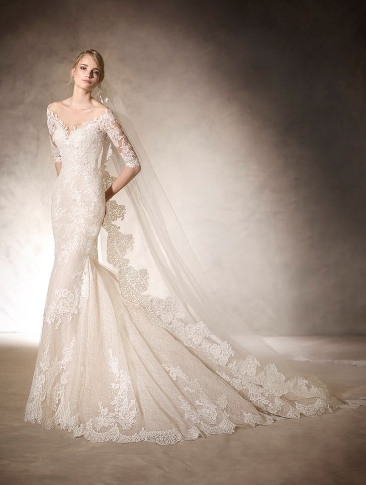 HITO - Incredible mermaid wedding dress with sweetheart neckline made from tulle and embroidered tulle in off white.