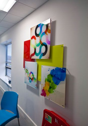 Corporate art - acrylic panels and standoff hardware   www/peregrineplastics.com