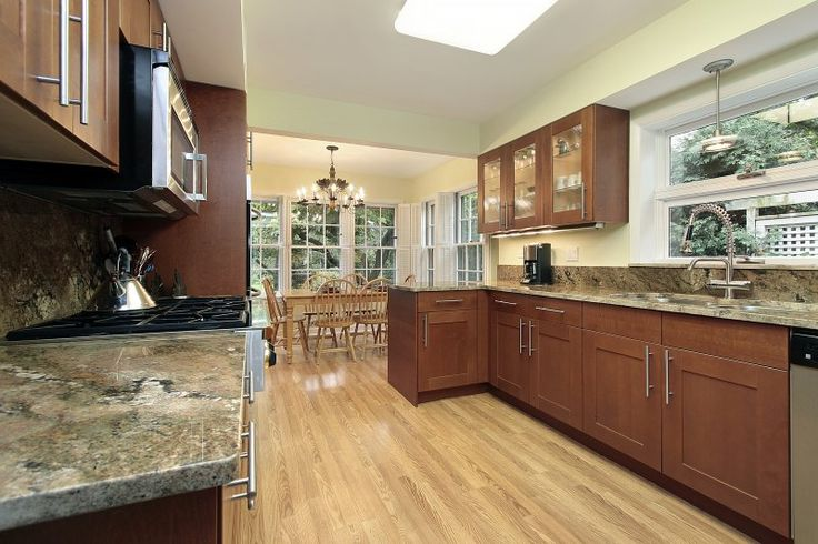 Galley Style Kitchen With Dark Wood Shaker Style Cabinets