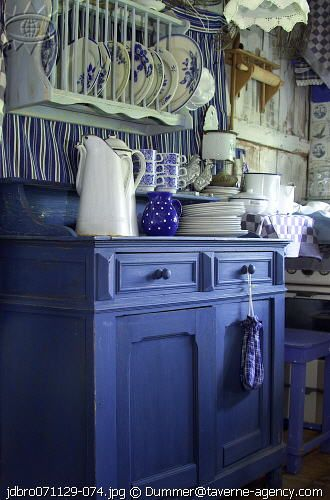 blue and white kitchen - I love the color of blue on the buffet and the plate rack!