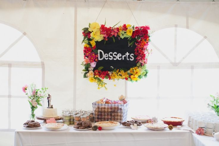 Every tent wedding deserves a sweets table full of homemade pies and popcorn!