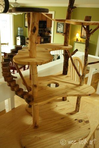 Was für ein wunderschöner, selbstgebauter Kletterbaum. Ich wünschte, ich könnte auch so etwas...