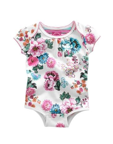 Joules Baby Girls Romper Suit, Creme Garden Floral.                     One of the prettiest babygrows we've ever designed. In super-soft cotton adorned with a floral print, tiny little frills and poppers for easy-on-and-off.