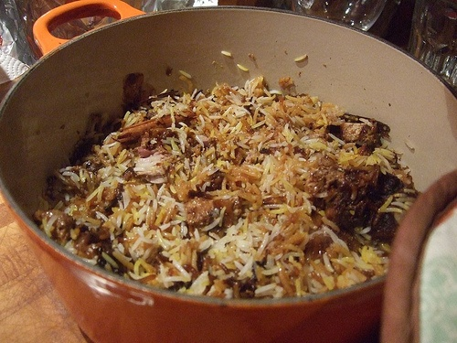 Biryani - a rice (usually basmati) dish served with spices, chicken, mutton, fish, eggs, or vegetables. Order it in Bangladesh and other parts of South Asia.