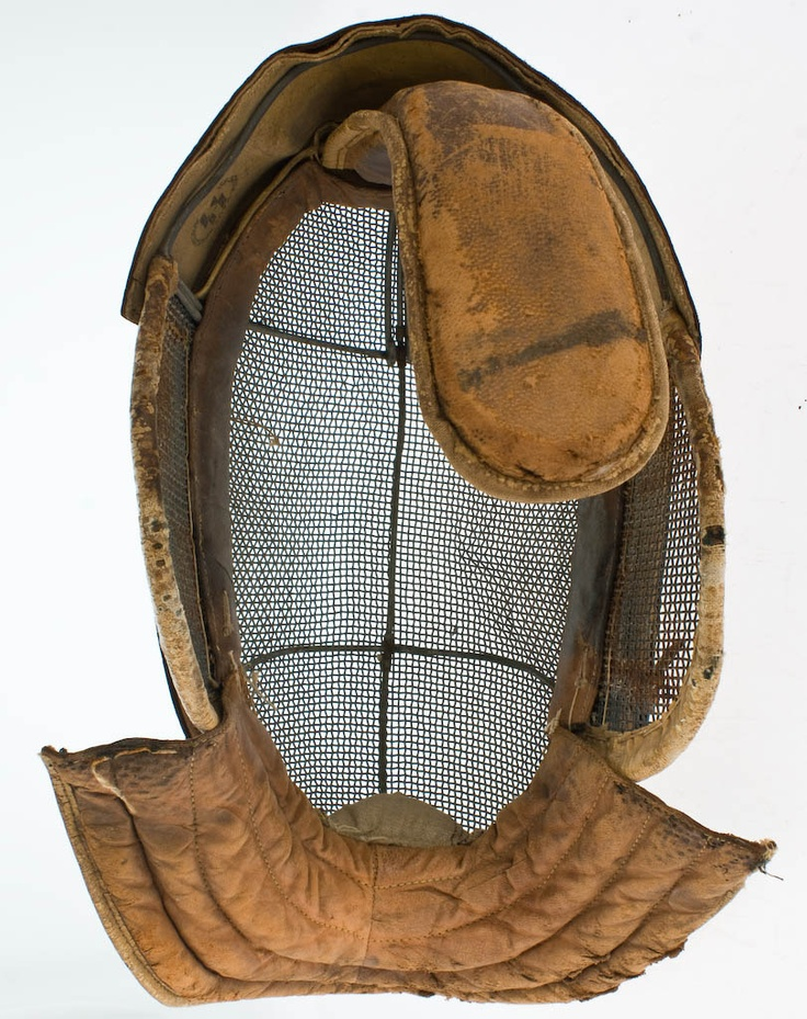 This is a leather fencing mask from the SS Schule Haus Wewelsburg, an SS officer training school at Wewelsburg Castle in Germany during the Third Reich (1933-1945).  It is made of leather, with an internal metal support system and metal screen face shield.  It is designed to provide full facial protection with a minimum of visual impairment for the wearer.  The interior features two black inkstamps, one is the official stamp of the Wewelsburg school from 1940,1 the other is the double Sig…
