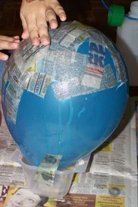Paper Mache Balloon... Could do this in pairs to make the enormous turnip
