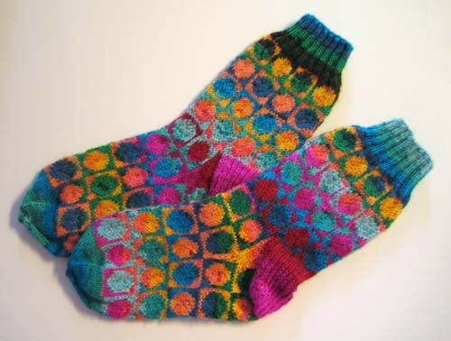 """sometimes it's the yarn choice that makes the pattern -- maker says, """"Made these from the new tico tico yarn, using the blue-green and the red-yellow colourway."""""""