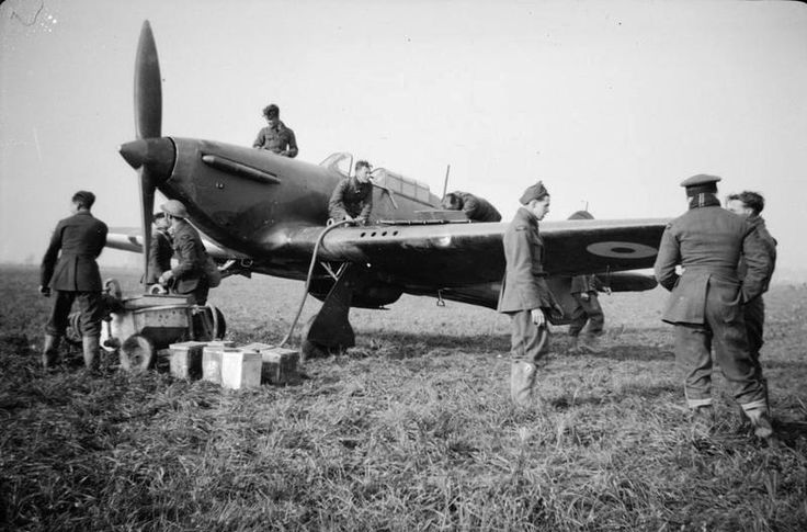 "Hurricane Mk I LK-A flown by P/O William D ""Dennis"" David of No 87 Squadron RAF is refuelled at Seclin in May 1940. Prior to the German invasion in May 1940, the aircraft had a crowned red lion on a yellow crest painted onto its starboard cockpit door with eventually five small skulls added as David's victory markings above the artwork. A rigger unhinged the door soon after the aircraft had been abandoned at Merville and brought it back to England for eventual presentation to the squadron."