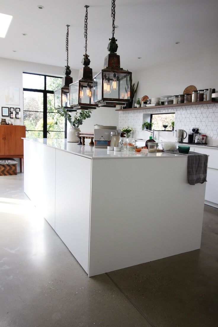 White kitchen with big island | grey concrete floors | large vintage copper lanterns | Friday favourites