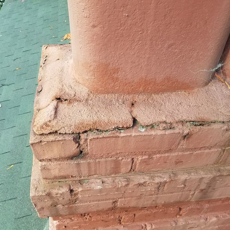 Bad cracks in the cap and mortar joints. Mortar