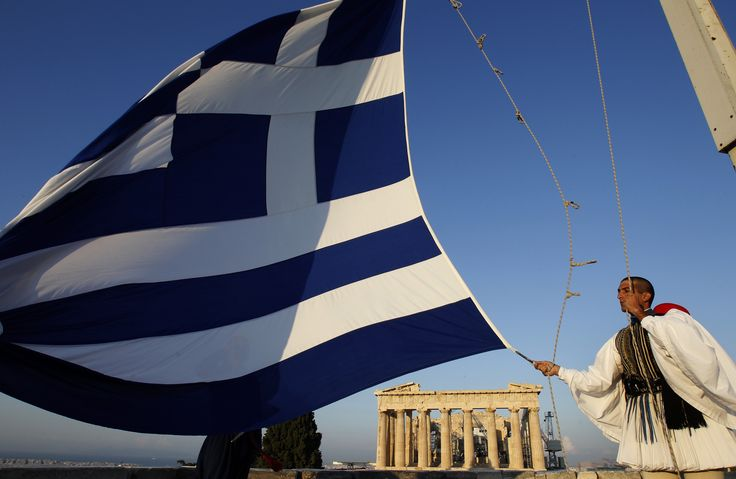Evzone hoisting the flag of Hellas