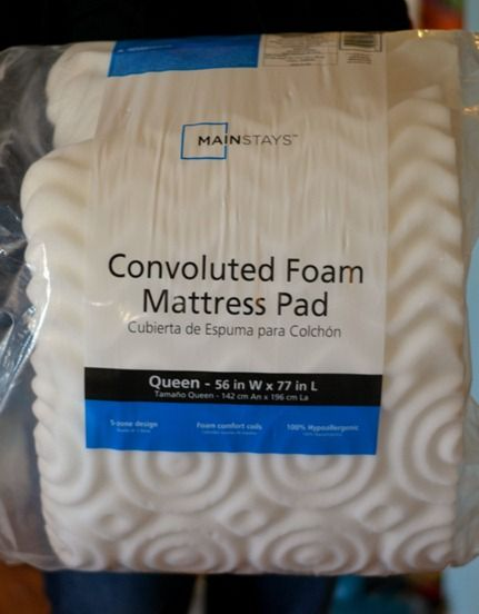 use two queen mattress pads (A.K.A. egg crates) with the curved sides facing each other as  foam.