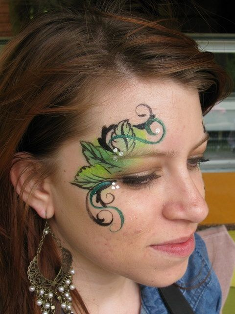 Do leaves with one stroke and maybe a couple of flowers for a fairy design.
