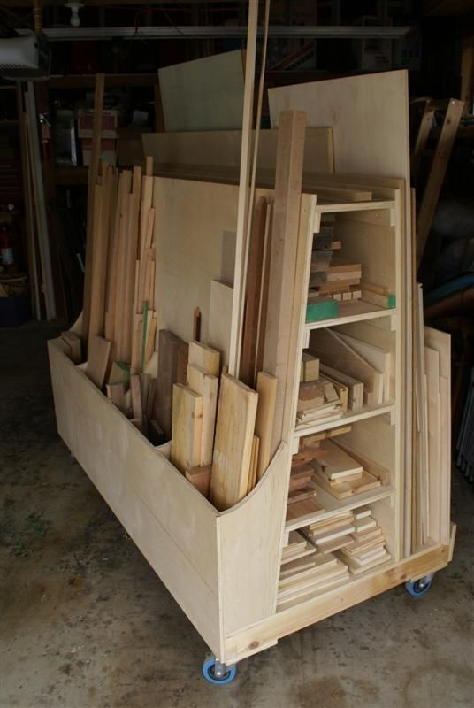 DIY: Lumber Storage System Tutorial ~ This is awesome! The slots allow you to organize horizontally & vertically, keeping lumber off the floor & similar lumber together & it's on casters!!! by soulouttaki