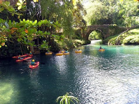 White River Valley - Ocho Rios - Prides itself on its Eco credentials, offering all manner of outdoor adventures.  The white limestone rocks give the White River its name, causing the water to tumble over rapids and forming tranquil lagoon pools for rafting.  You can go tubing or kayaking in the White River, or even saddle a horse for a ride along trails leading through tropical rainforest! Visit the landscaped Village of Flowers, and seek out the old Spanish Bridge dating back to the 1600s