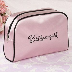 "WeddingDepot.com ~ Medium Travel Bag - Bridesmaid ~ The edges are lined in black satin, including the zippered opening at the top.  The front side is embroidered with the word ""Bridesmaid"" in black."