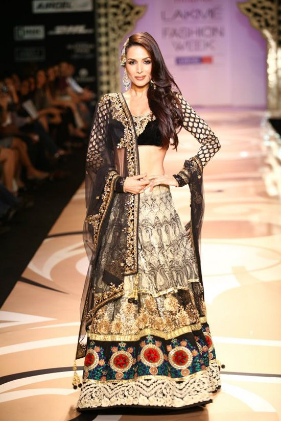 The black, cream, gold and red lehenga, along with the side-swept hair, is just stunning.