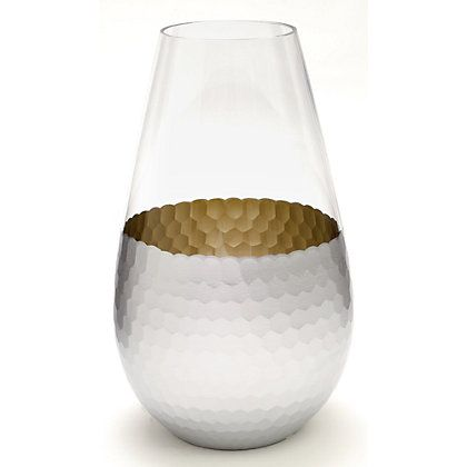 With its hammered texture and cool, shining glow, this unique vase adds decorative polish to floral arrangements.