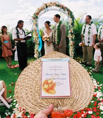Turn your wedding programs into fans to keep guests cool! | Photo by Stewart Pinsky Photography