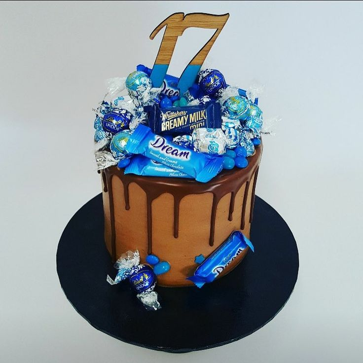 Smooth chocolate with Blue Overload Toppings and cake topper from Inscribe Design