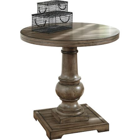 "The Vennilux round end table is all about finding beauty in clean shapes and classic silhouettes. Vintage gray undertones on the ""weathered"" wood fini..."