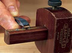 One of your first steps is to set the tips of the mortise gauge spurs to the width of your mortise chisel.