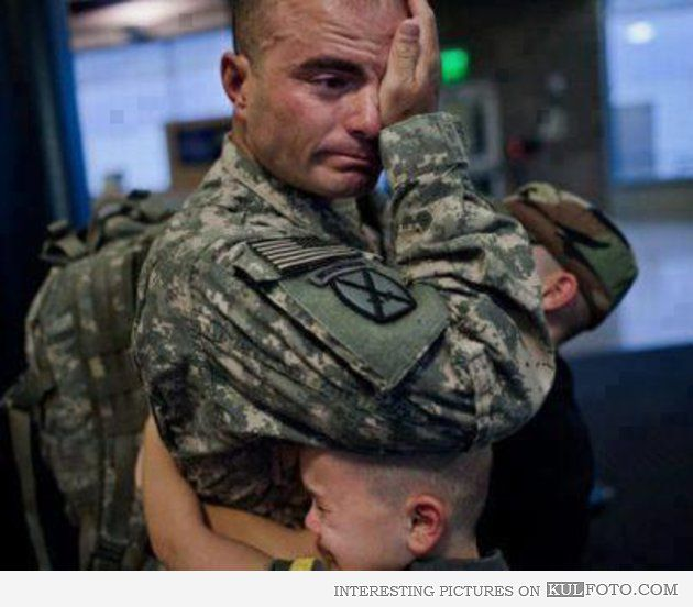 Coming home - Touching picture of crying soldier getting hugged by his little sons after returning home.
