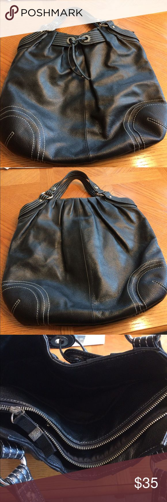 Via Spiga Large Black Tote Bag Via Spiga large black tote with contrast white stitching. Bag would be in almost perfect condition except for missing silver accent at bottom of cord (as seen in last picture). Priced to sell!!! Via Spiga Bags Totes