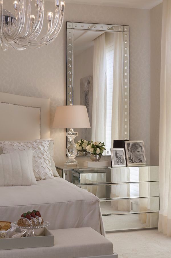 White bedroom with mirrored table