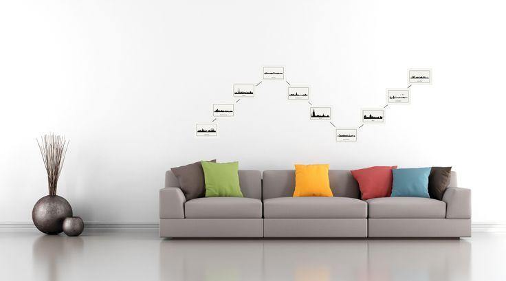 Eine wunderschöne Art Fotos   zu präsentieren. Ein Stahlseil wird in der gewünschten Form an der Wand befestigt und die Fotos werden mittels Magneten gehalten.