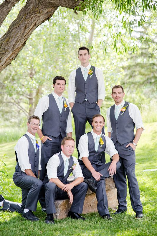 Groomsmen in elegant formal but handsome pose with groom for bridal party pic. Wedding at Spruce Mountain Ranch in Larkspur Colorado Ryan loves Corie Photos by Katie Corinne Photography