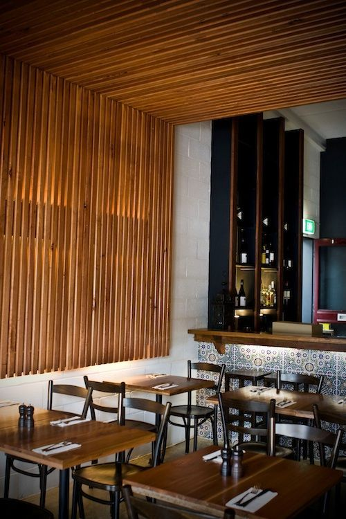 Radial Timber pencil round dressed screen boards in Silvertop Ash have been used to create a stunning effect in this modern beachside café. Details: http://radialtimbers.com.au/portfolio-type/anglesea-cafe/