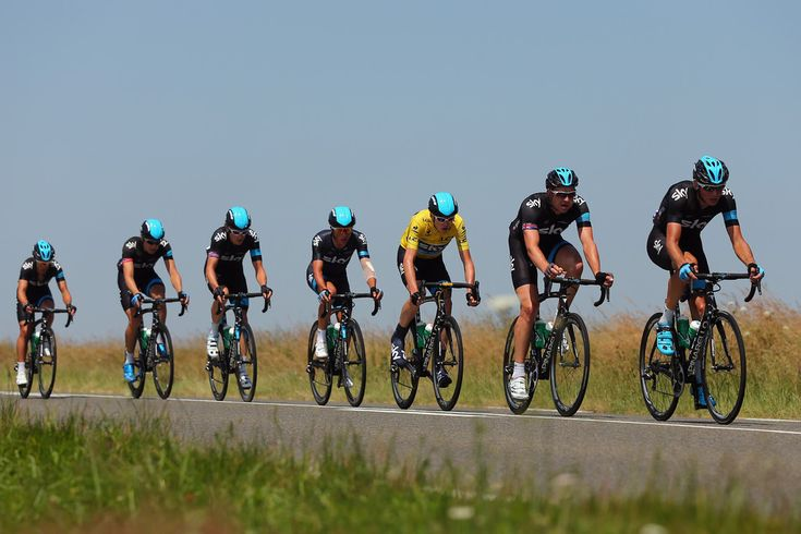 (L-R) Richie Porte, Edvald Boassan Hagen, Geraint Thomas, Peter Kennaugh, race leader Chris Froome, Ian Stannard and Kanstantsin Siutsou of Team SKY Procycling ride in the peloton during stage twelve of the 2013 Tour de France, a 218KM road stage from Fougeres to Tours, on July 11, 2013 in Tours, France.