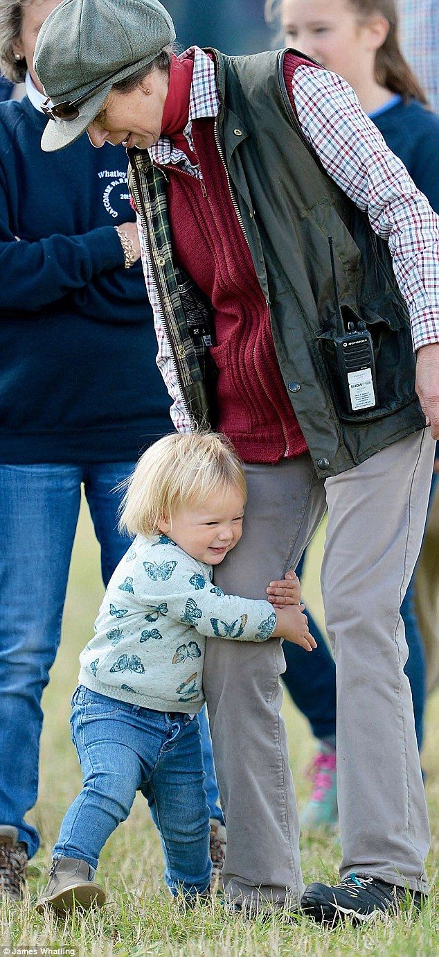Adorable:Little Mia, who turned one in January, clung tightly to the Princess Anne's leg in a sign of affection