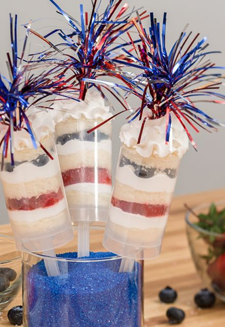 Start with a white cake and cut circles into slices to make patriotic push-DecoPops® cake pops. Alternate cake, white icing, sliced strawberries and blueberries. Top it off with Independence Day mylar spray DecoPics®.