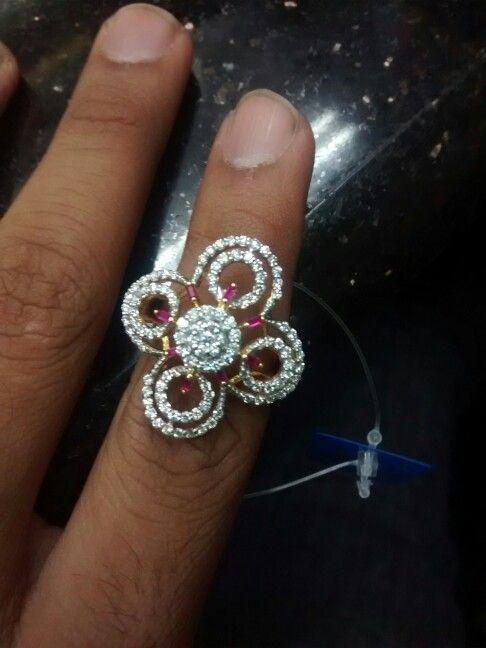 Nice..beautifull designed..with diamonda n gold..ladies ring