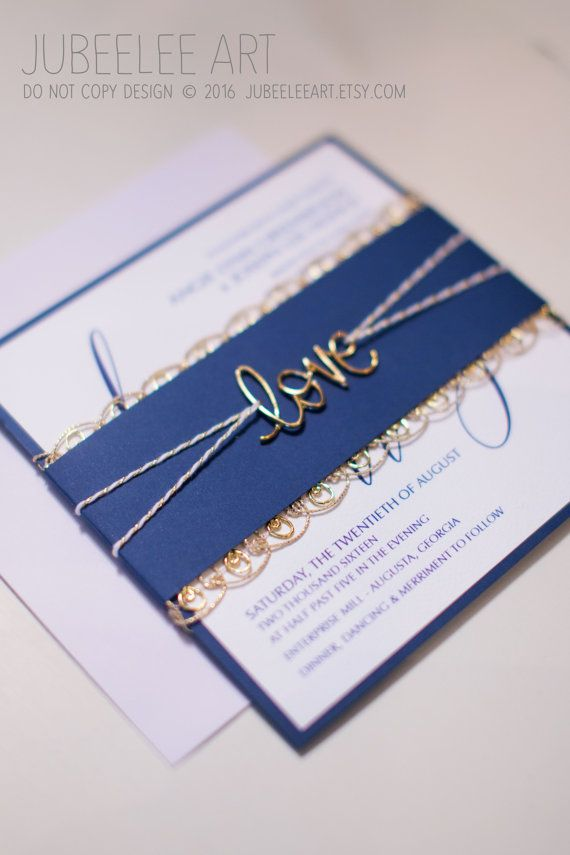 "cute navy and gold square wedding invitation with gold wire metal ""love"" tied with twine and belly band."