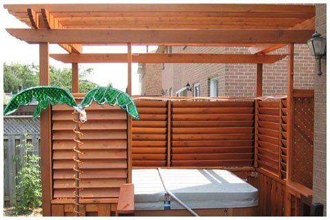 Louvered Spa Enclosure - kg: I like this look much more than just horizontal slats stacked on top of each other. This has a more traditional vibe.