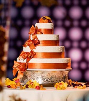 Wedding Cakes: Autumn and Fall wedding cake with gold orange ribbons and foliage leaves