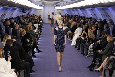 Chanel - Karl Lagerfeld presents his collection on an a runway made to look like the interior of an airplane.